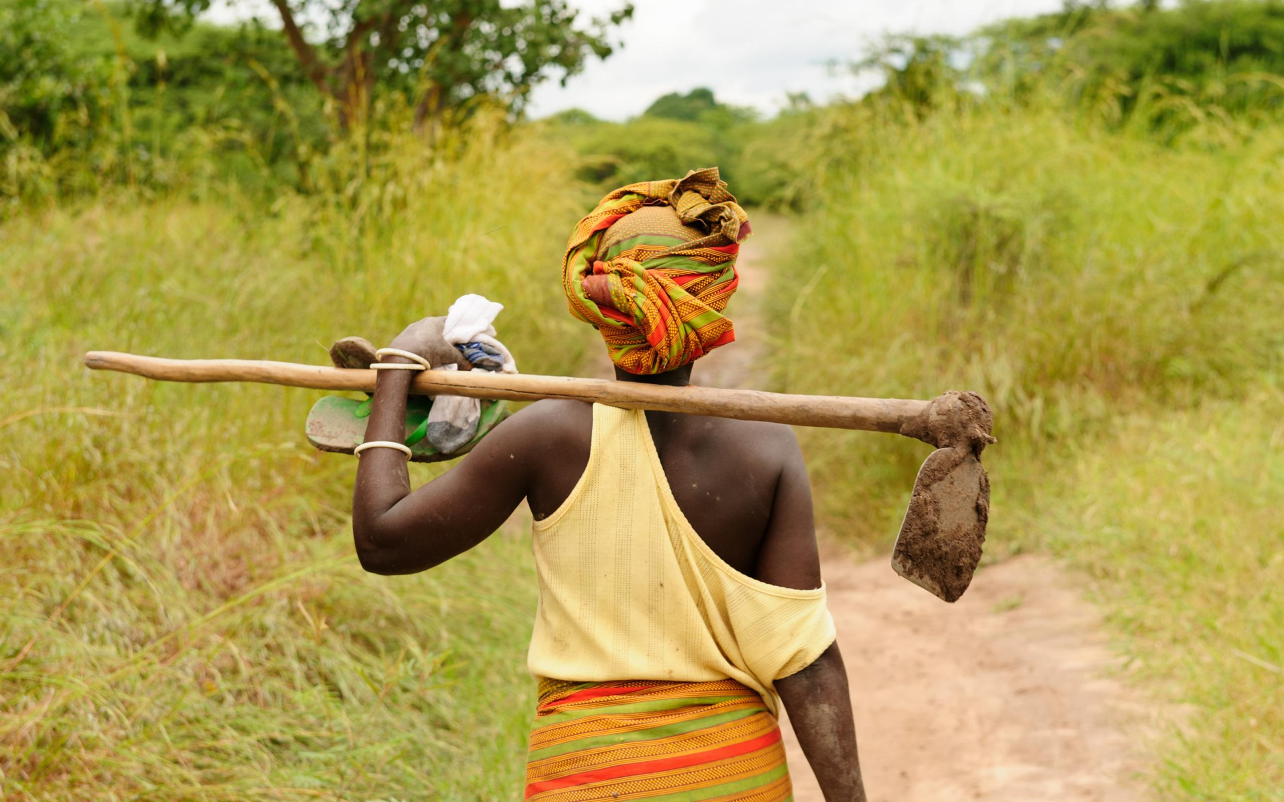 Woman walking with farm tool